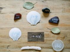 Charlie Whiskey turns unconventional materials— shells, sea glass, stones, leaves, you name it—into place cards using organically modern calligraphy. Wedding Table, Diy Wedding, Wedding Decorations, Table Decorations, Modern Wedding Invitations, Name Cards, Event Styling, Modern Calligraphy, Bat Mitzvah