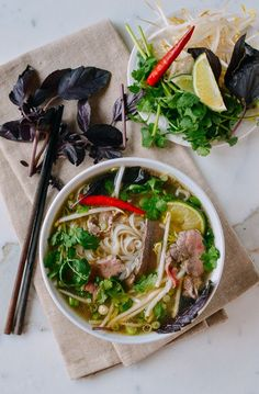 Pho is a Vietnamese noodle soup topped with awesome things like fresh bean sprouts, basil, and chilies and this pho recipe was approved by a Vietnamese friend!