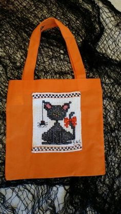 Kitty cross stitch candy bag compliments of Gramma.