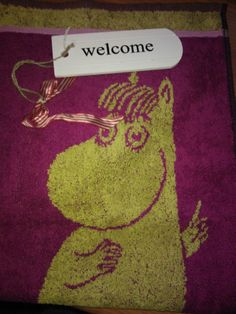 Welcome kyltti ja niiskuneiti käsipyyhe