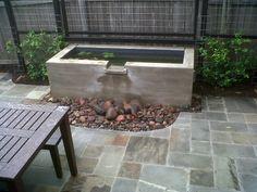 cool concrete fountain/pond