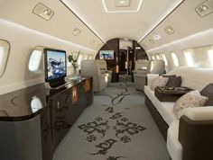 Living room aboard a #luxury private #jet, complete with #custom upholstery and amenities