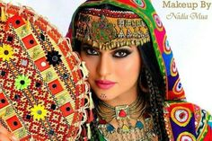 Afghan Pashtoon girl presenting Afghan jewelry with dress design