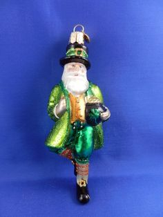 Have some luck of the Irish with this cute Irish Santa by Old World Christmas. He is carrying a pot of gold with a shamrock on it.