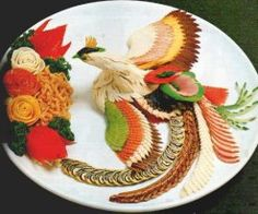 15 Amazing Examples of Food Art - Culinary Phoenix - This food artwork is going to blow your mind! A phoenix, feathers, and roses all made out of food - Does it get any better than this? The creativity and skill involved in this is unbelievable. L'art Du Fruit, Deco Fruit, Fruit Art, Fruit Cakes, Food Design, Cute Food, Good Food, Funny Food, Amazing Food Art