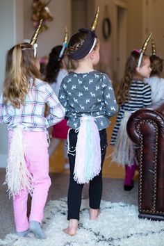 Girls in Unicorn Attire from a Rainbows & Unicorns Birthday Party via Kara's Party Ideas KarasPartyIdeas.com (8)