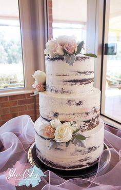Semi naked wedding cake www.slicecakes.com