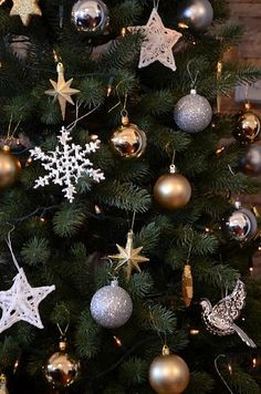 Gold and silver Christmas tree décor. Just missing some sheer gold ribbon or garland.