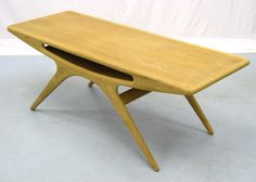 Coffee table with magazine shelf by Johannes Andersen, manufactured by CFC Silkeborg.