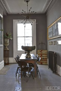 Love the folding chairs and painted floors...they give casual touches to this formal building!  Great stacked books in the corner too!   - ELLEDecor.com