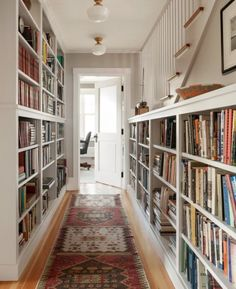 A long narrow hallway is a dreamy place to organize your entire book collection.