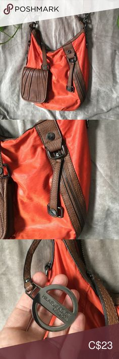 """Hilary Radley Orange Crossbody Shoulder Bag Purse Can be adjusted into a shoulder/crossbody bag. Strap is very durable/good quality. The buckles at the end detach and can be buckled into the lower loops to make a smaller strap. Materials: 100% polyester outside, leather like material: mix of polyester and PVC. Lots of little pockets. Very good condition. Only signs of wear: small ink dots on bottom of inside lining, a small nick in the """"leather"""" on the zipper band. Dimensions: 12 W x 13 H x… Crossbody Shoulder Bag, Crossbody Bag, Radley, Purses And Bags, Dots, Pockets, Zipper, Ink, Orange"""