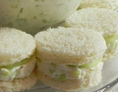 Cucumber sandwiches - love them! I normally do mine on a darker bread - pumpernickel or rye (cut the crust off) Rye, pumpernickel, & whole grain can also be purchased as Cocktail Breads loaves, which are really delish :^) You can use whipped or regular cream cheese (softened) with a ranch seasoning mix, mayo, dice the cucumber and mix in with spread or slice and use spread as a condiment.... you can season with mint, dill, pepper, tarragon or whatever suits your taste buds!