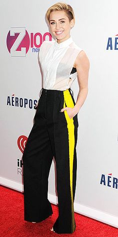 MILEY CYRUS How many people woke up this morning and put on a collared button-down and wide-leg trousers for work? Of course, when Miley sports the separates (for the Jingle Ball in N.Y.C.), she puts her own NSFW spin on things by picking a sheer, side-tie top and pants with a yellow racing stripe (both Maison Martin Margiela).