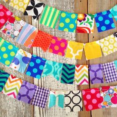 100 flags of mini scrap bunting in bright colors and patterns.each bunting is 13 feet long.