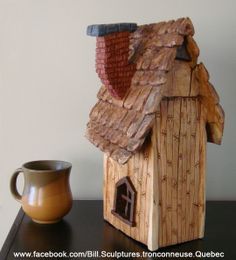 Carving house fairy whimsical Made by Bill carver: https://www.facebook.com/Bill.Sculptures.tronconneuse.Quebec