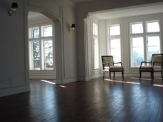 Dark lovely hardwood floors throughout and detailed moldings