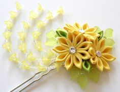 The flowers are made in the technique of tsumami kanzashi. Flowers are made from grosgrain ribbons. Swarovski crystal.  Flower`s diamater is ~ 2 1/2 inch (