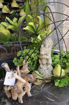 A sweet garden figurine finds refuse in this garden sphere!