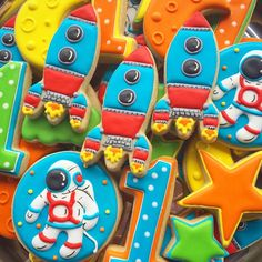 Brightly colored space cookie set with astronaut, space ship, stars by Banana Bakery