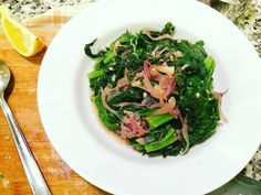 Mustard greens sauteed in red onions, garlic, and vinegar