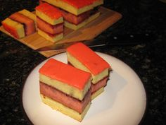 Punch Cake (Punčové Rezy) -  Punch cake is a three layer cake consisting of a middle layer soaked in a rum-based punch. The layers are joined with jam.