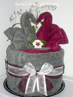 A beautiful towel cake made with towels the color of the wedding.