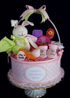 Basket Diaper Cake made for Baby's 1st Easter. www.facebook.com/DiaperCakesbyDiana