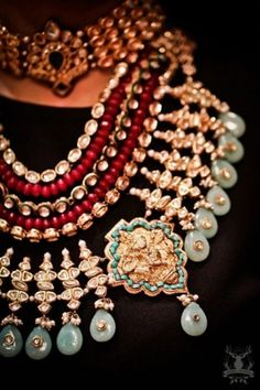 Indian Wedding Jewelry - Chunky Multilayered Jewelry with Red Stones Strings and Pastel Stones | WedMeGood Find more jewelry designs on wedmegood.com #wedmegood #pastel #jewelry