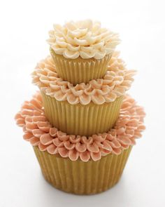 Three piped-chrysanthemum cupcakes stacked atop one another make a super-sweet display for a shower. Just as the cupcakes are graduated in size, from jumbo to mini, the buttercream is tinted in varying degrees of the same shade to create this budding beauty.
