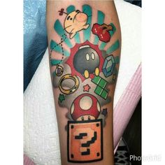 Fun Video Game Tattoo by - Gamer House Ideas 2019 - 2020 Nintendo Tattoo, Gaming Tattoo, Unique Tattoos, Cool Tattoos, New Tattoos, Family Tattoos, Gamer Tattoos, Tattoos For Guys, Tattoo Design Drawings
