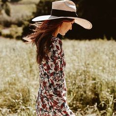 The wild is calling me. Nothing like a flowy print dress topped off with a wide brim hat.