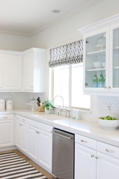 Backsplash: Walker Zanger. Counters Caesarstone Frosty Carrina
