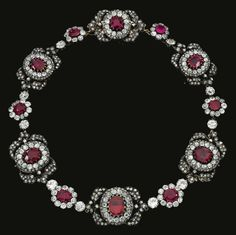 Ruby and diamond necklace, 19th century. Designed as a series of cluster and foliate motifs, each set at the center with oval and cushion shaped rubies, the central motif set with a foiled back garnet, highlighted with circular cut and rose diamonds, each element detachable and could be worn as separate jewels or as a tiara. Could be early 19th century or Georgian period