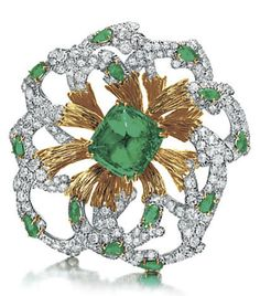 Lot 372 – AN EMERALD, DIAMOND AND GOLD BROOCH, BY DAVID WEBB