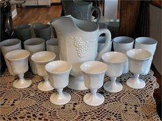 ITEM #RA-47 (Box R-1)    This is a mid century 1960s Indiana Glass Colony Harvest milk glass aka Grape and Leaf large pitcher set including 6 tumblers and 6 goblets.   Pitcher is 10 1/2 tall and weighs 5 lbs 8.5 oz.   Tumblers are 6 tall and each weigh 15.7 oz   Goblets are 5 1/3 tall and each weigh 11.2 oz.   Due to the weight, this set will be professionally wrapped, tracked and insured through UPS.   Condition: Very good antique condition with typical wear due to age and handling...