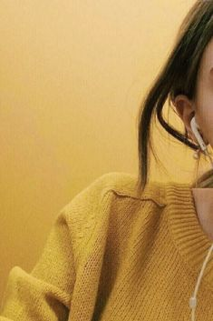 Side picture of a girl in a yellow sweater against a yellow background. Side picture of a girl in a yellow sweater against a yellow background.