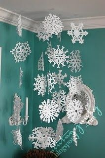 Snowflake garland. This would be a fun DIY decoration.  Would love these on some greenery hung on top of curtain rods.