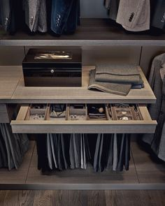 Dressing room storage solutions - trouser hanger with drawer for watches, etc. Examples are displayed in Beaufort Interiors