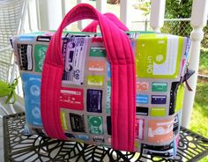 The Toiletry Tote free pattern. This is a slightly different method of sewing a boxy bag, but is has an inner zip pocket, and handles.