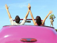 Picture of Freedom - happy free couple in car driving in pink vintage retro car cheering joyful wih arms raised. Friends going on road trip travel on summer day under sun blue sky. stock photo, images and stock photography. Stress Management, Best Road Trip Songs, Couple In Car, Relation D Aide, Long Car Rides, Road Trip Hacks, Road Trips, Camping Essentials, Travel Tips