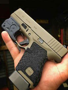 I like the Cerakote/stipple job on this Glock