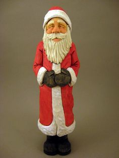 This is a hand carved Santa, Has a small amount of wood burning, painted with acrylics. measurments are approximately 10 3/8 inches tall. 3 1/4
