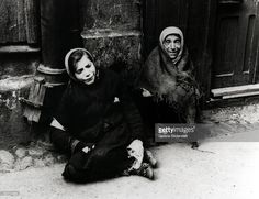 A girl and a woman begging in the Warsaw Ghetto during World War II, Poland, 1941.