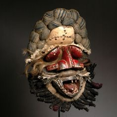 Africa | Mask from the Guere or We people of Liberia | Wood, raffia, cloth, rope, paint, pigment, resin, metal and hair | ca. mid 20th century