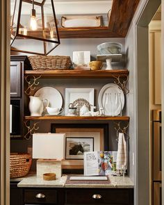 The dark butler& pantry in stylist Natalie Nassar& Atlanta home The dark butlers pantry in stylist Natalie Nassars Atlanta home Atlanta Homes, Upholstered Ottoman, Butler Pantry, Coastal Cottage, Large Furniture, Beautiful Family, French Country Decorating, House Tours, Shelving