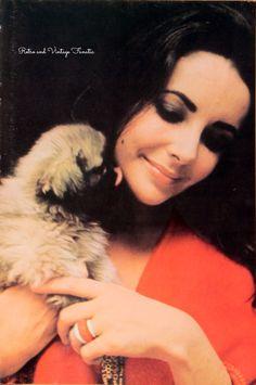 Elizabeth Taylor and her Pekingese Puppy.