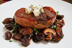 Double Smoked Bacon Wrapped Filet Mignon with Caramelized Mushrooms topped with Blue Cheese