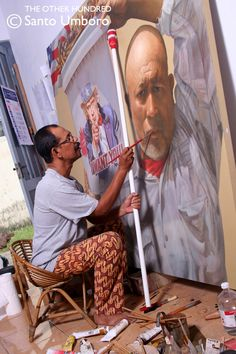 Mahdi Abdullah, 53, is an Indonesian painter, whose life has been shaped by the 30-year war fought between separatists from the province and government forces. (Photo by Santo Umboro)