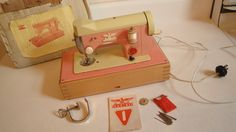 pink and cream vintage toy machine
